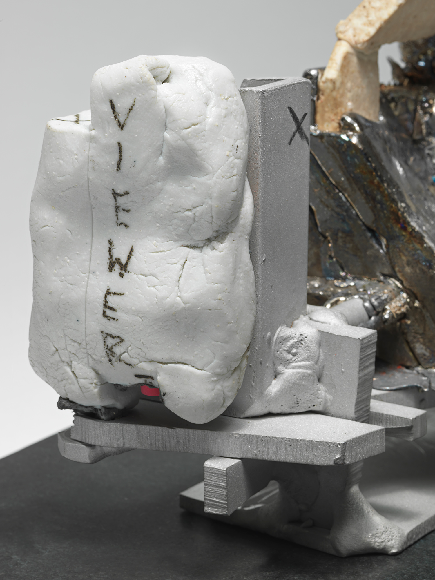 "GHOST_VIEWER . Detail. Porcelain, lead, aluminum, granite. 4.25"" x 12"" x 5"". 2014."