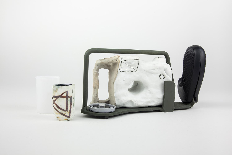 """HOLEBLOCKER_VIEWER . Porcelain, aluminum, rubber, film canister. 4"""" x 8"""" x 2.25"""". 2015."""