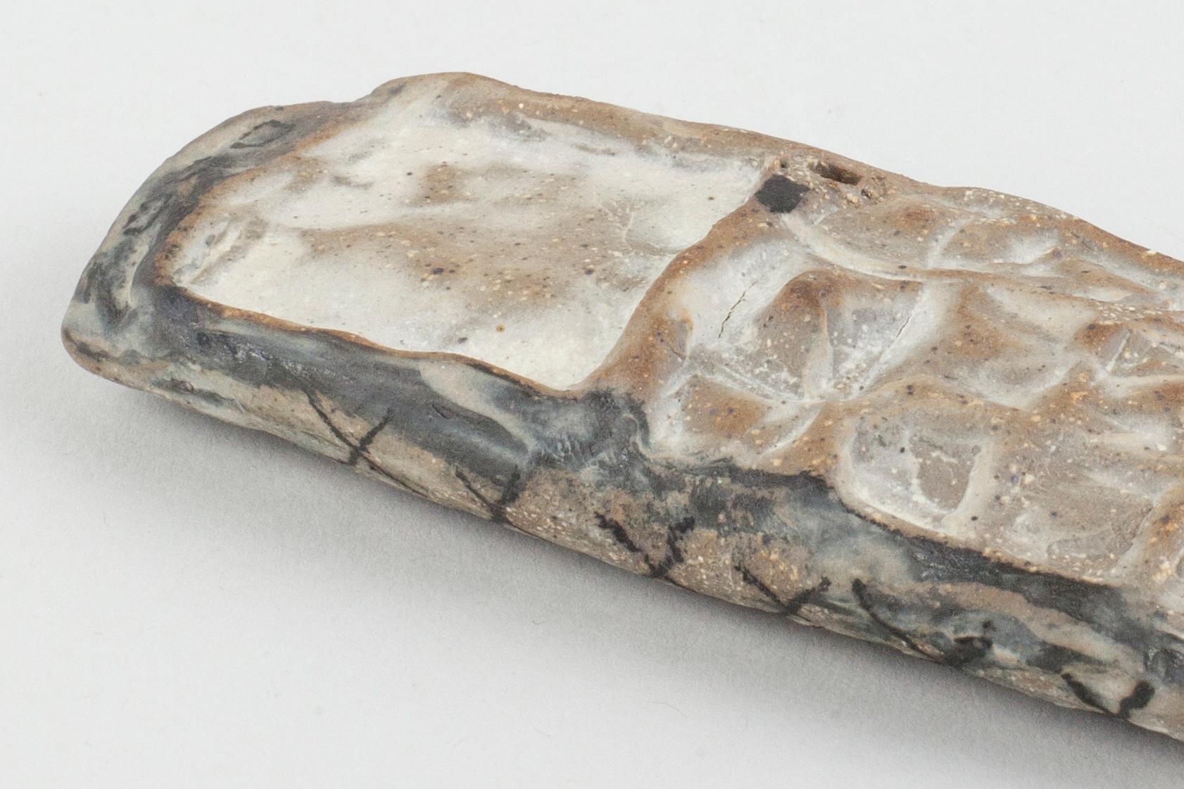 "Burner 5 . Detail. Stoneware. 4.75"" x 1.75"" x 1"". 2015."