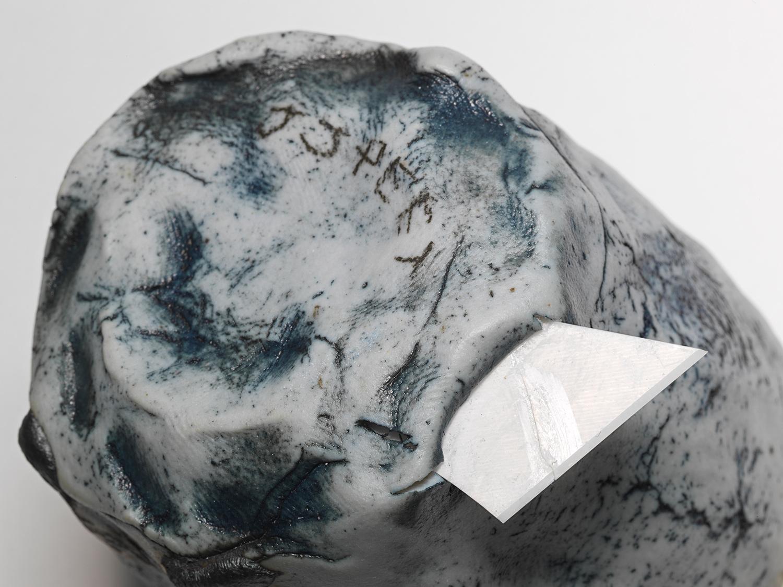 "DECOY_Cup_4 . Detail. Porcelain, porcelain blade, cardboard, granite. 7.5"" x 7"" x 5.5"". 2014."
