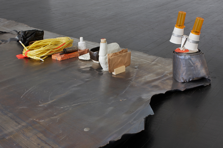 "DEFEND_Station (Configuration_1) . Detail. Lead, porcelain, pine, plastic, paper, glass, aluminum, rags, gold, cupcakes, brass, feather, mild steel. 102"" x 111"" x 16"". 2012."