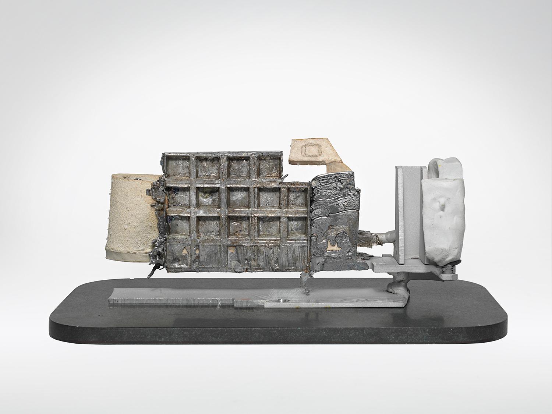 "GHOST_VIEWER . Porcelain, lead, aluminum, granite. 4.25"" x 12"" x 5"". 2014."