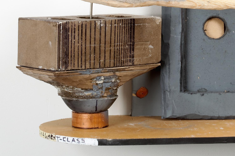 "Middle Management Mustache Prize . Detail. Oak, copper, ice pick, cardboard, plaster, brick, pink paper clip, correction fluid, chewing gum. 13"" x 16"" x 9"". 2009."