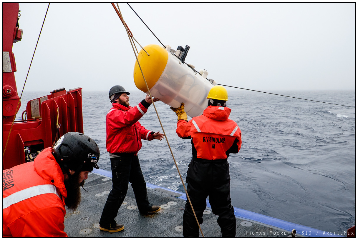 Crew of the R/V Sikuliaq ease a MP robot over the side.