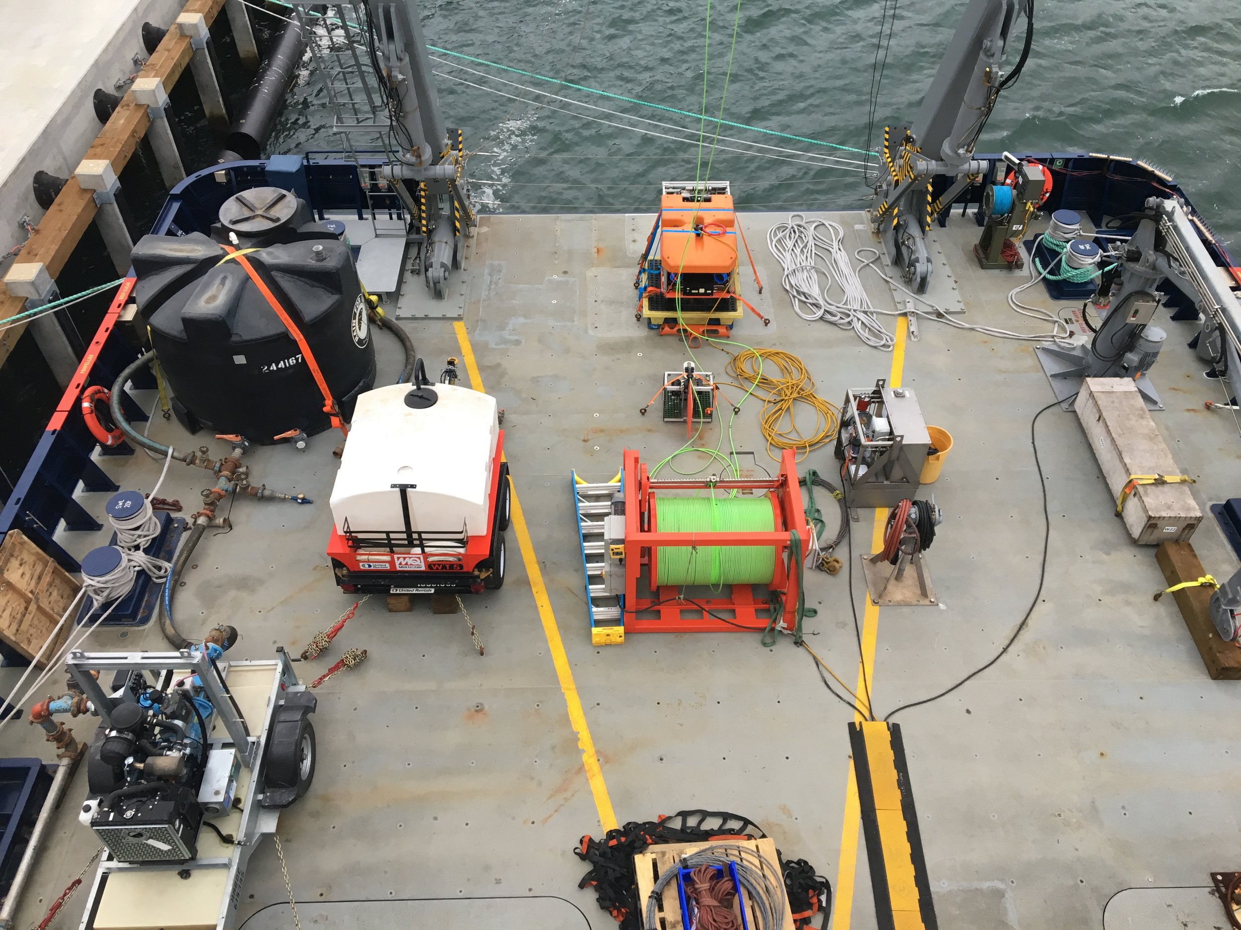 The remotely operated underwater vehicle (ROV) SIO Trident and associated equipment sits on the back deck of the R/V Sally Ride, ready for PLUMEX-related operations.