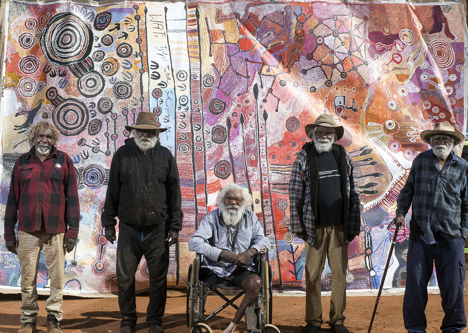 apy mEN'S collaborative 2016 WAS PAINTED BY 22 ARTISTS, INCLUDING (l-r)  Ronnie dOUGLAS, bRENTON kEN, wILLY kAIKA bURTON, mICK wIKILYIRI AND rAY kEN  (tJALA aRTS). iMAGE Rhett hAMMERTON.