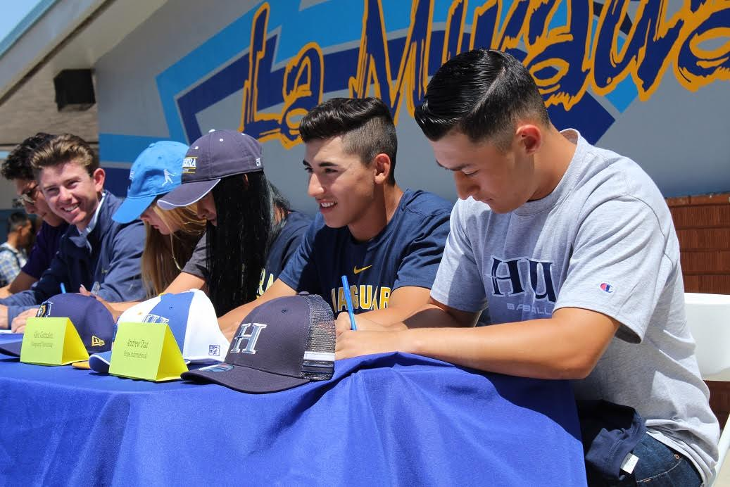 La Mirada High senior Andrew Diaz (right) committed to play baseball at Hope International, and signed his letter of intent on National Signing Day for spring sports.   Photo | NLMUSD