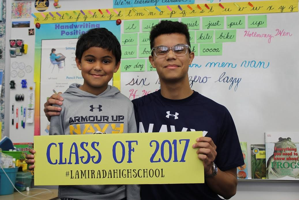 La Mirada High School senior graduate Ryan Rodriguez (right) talked about how he decided to attend the Naval Academy in his little brother's (left) third-grade class as part of Norwalk-La Mirada Unified's inaugural Kinder to College event.