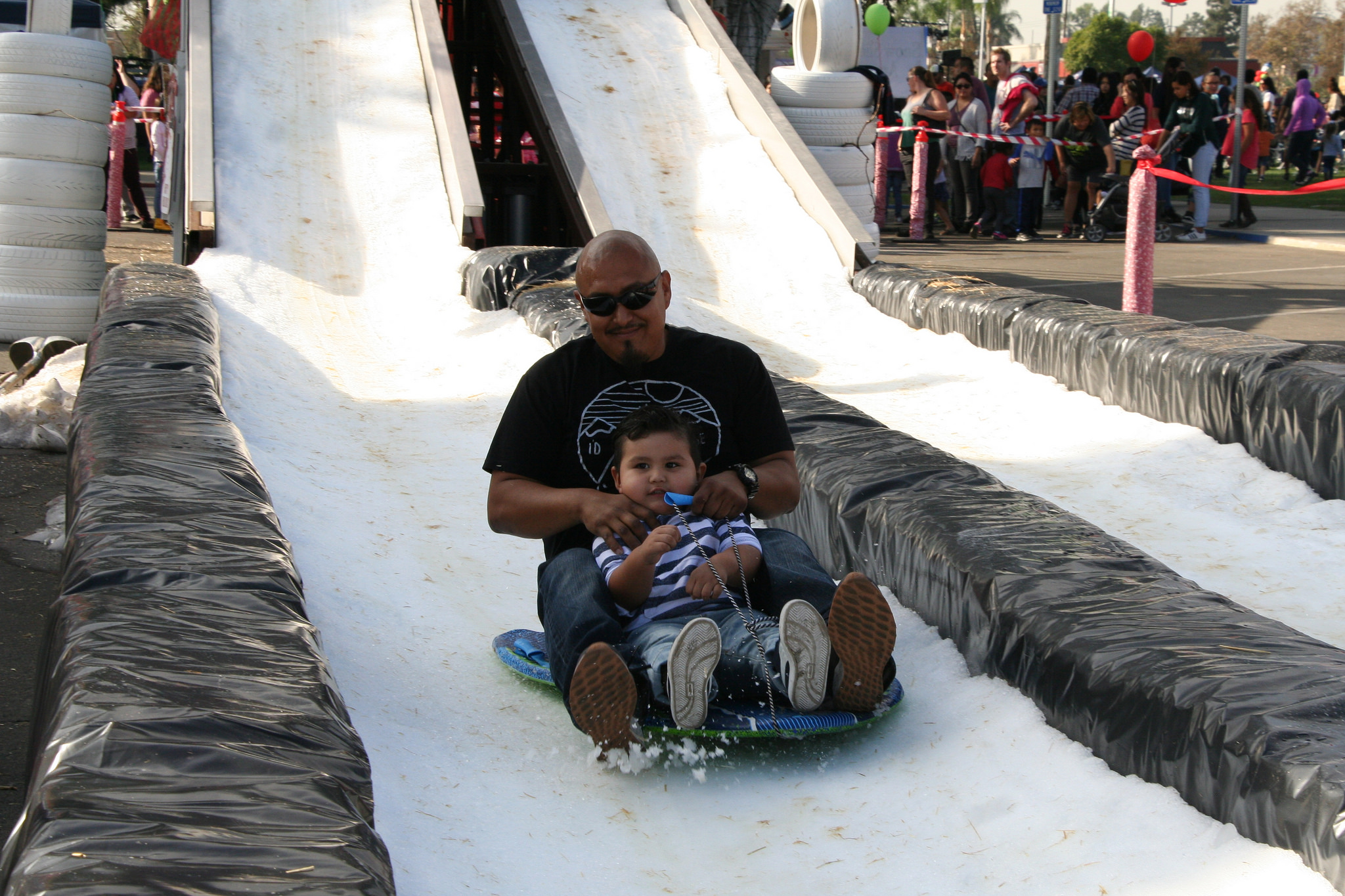 A real snow slide is a popular attraction at Norwalk's SnowFest. Photo courtesy City of Norwalk