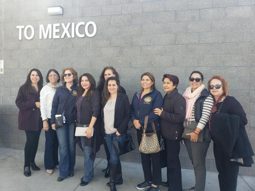 Assembly member Cristina Garcia, second from right, toured migrant shelters on both sides of the U.S./Mexico border.
