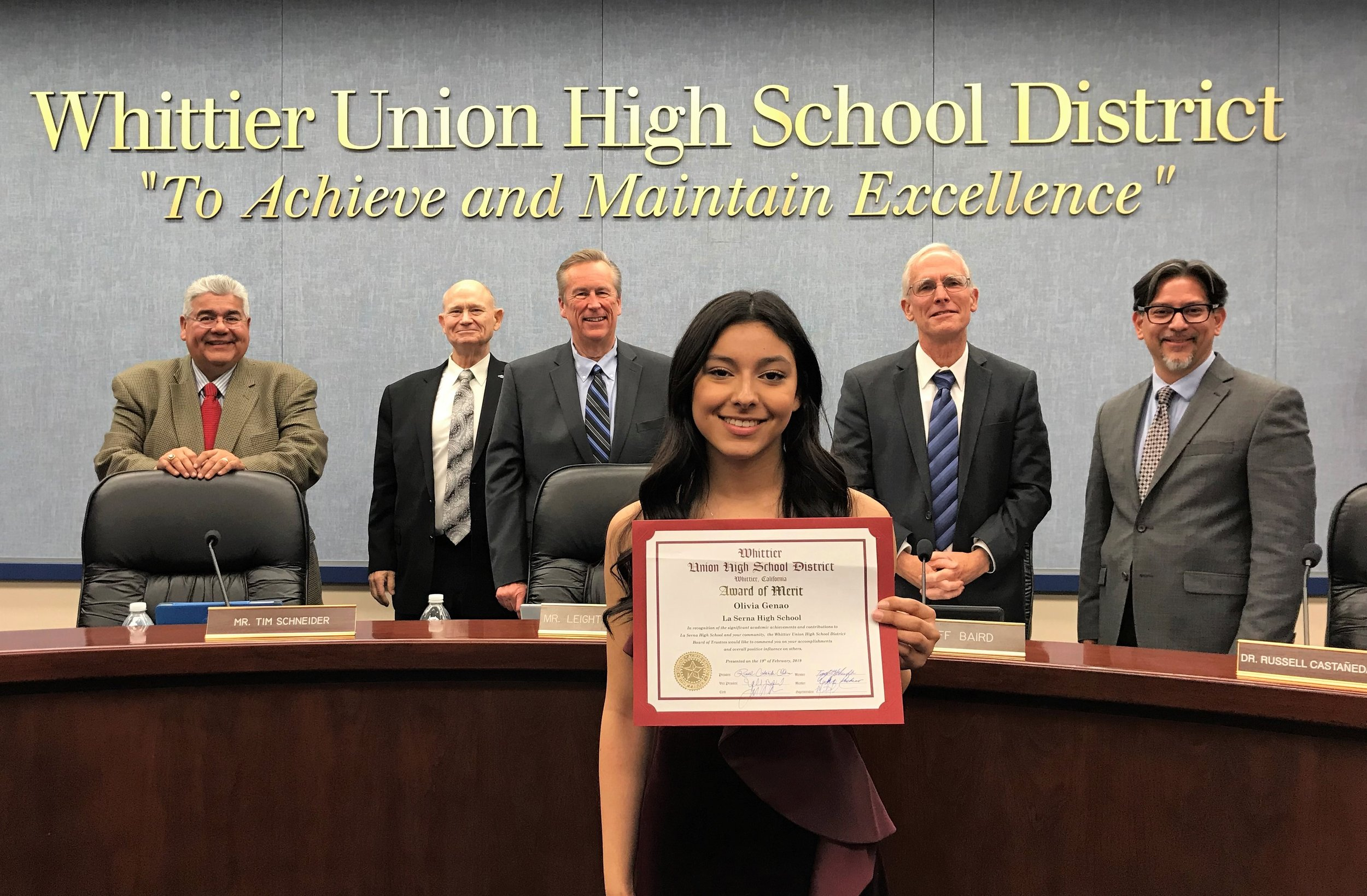 La Serna High School senior Olivia Genao, who gained early admission to Yale University, was honored with an Award of Merit by the Whittier Union Board of Trustees on Feb. 19. Pictured are Genao and Board of Trustees members Dr. Ralph Pacheco, left, Tim Schneider, Clerk Leighton Anderson, Vice President Jeff Baird and President Dr. Russell Castañeda-Calleros.