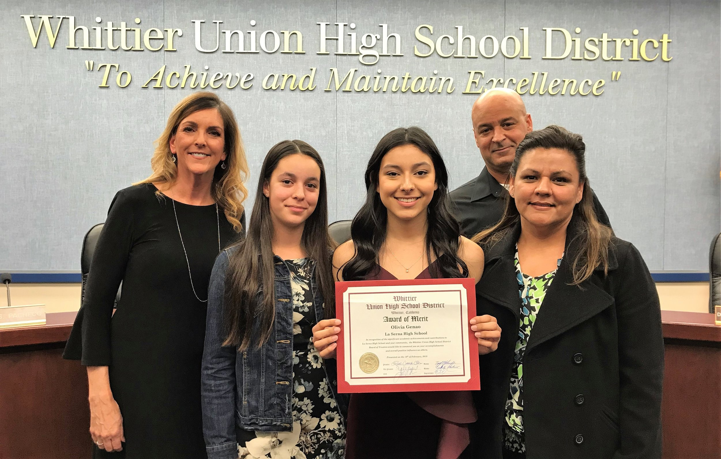 Olivia Genao is pictured with Principal Ann Fitzgerald, left, and her family.