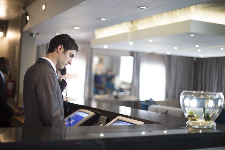 hotel-receptionist-on-phone-517791323-57685cc15f9b58346afdd6fc.jpg