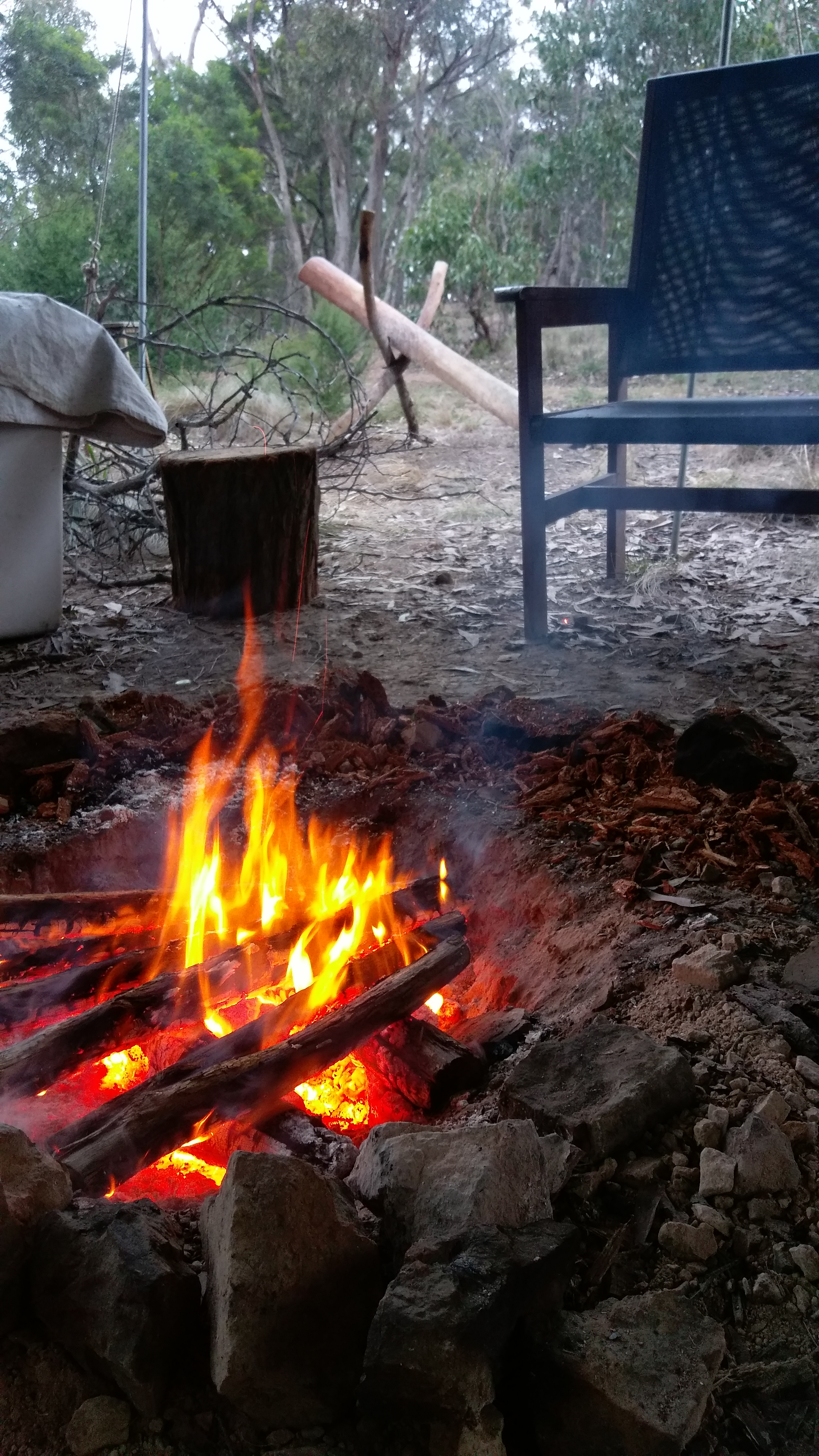Pictured: At The Bush Tannery we use an open fire pit during safe times of the year to cook over the fire. This fire will need to burn down to hot coals before cooking on.
