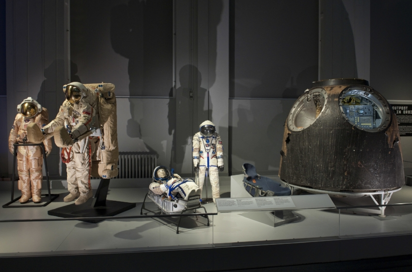 A selection of spacesuits and the TM-14 Soyuz descent module in the Cosmonauts exhibition