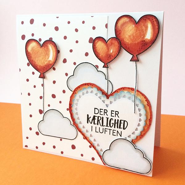 Til dette kort har hun brugt materialerne: Stempelsæt   Der er kærlighed i luften  , Papir   Smagen af jordbær sorbet  ,  Hjerte die  fra Nellie Snellen. Kortet er farvelagt med Chameleon Color tones