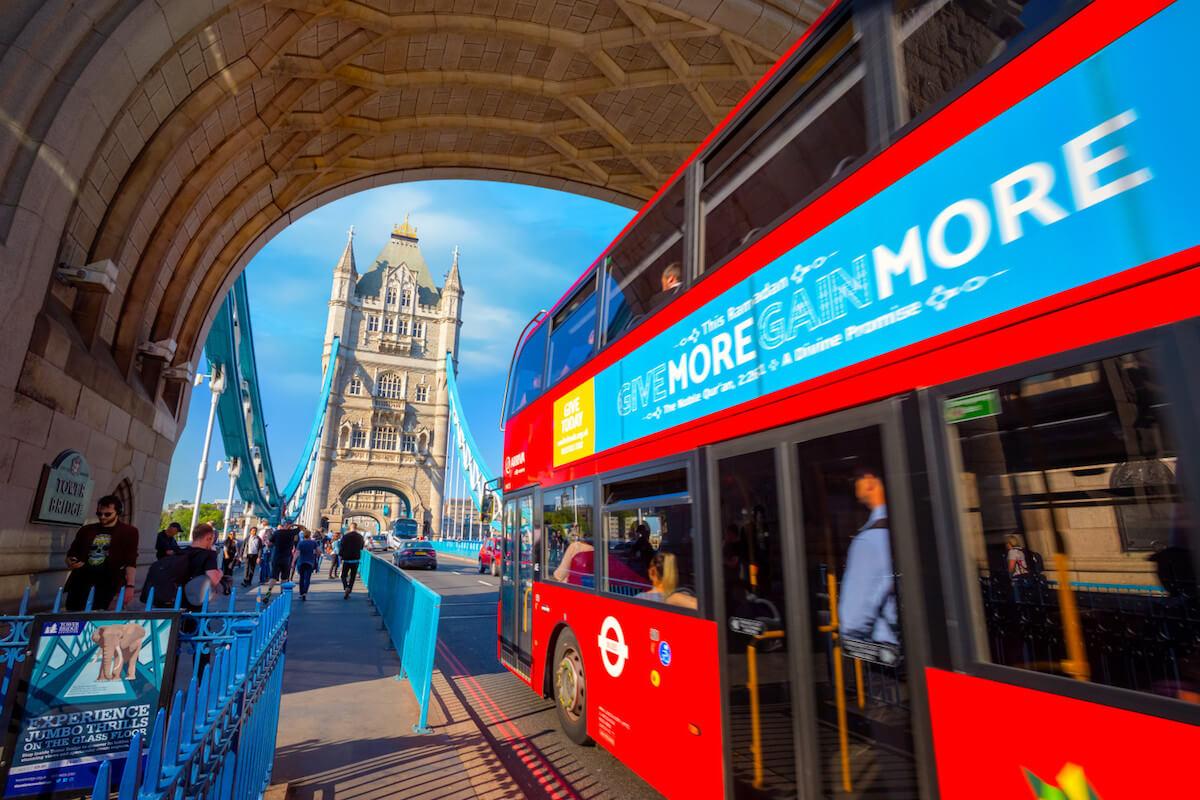 London bus crosses river thames over tower bridge.jpg