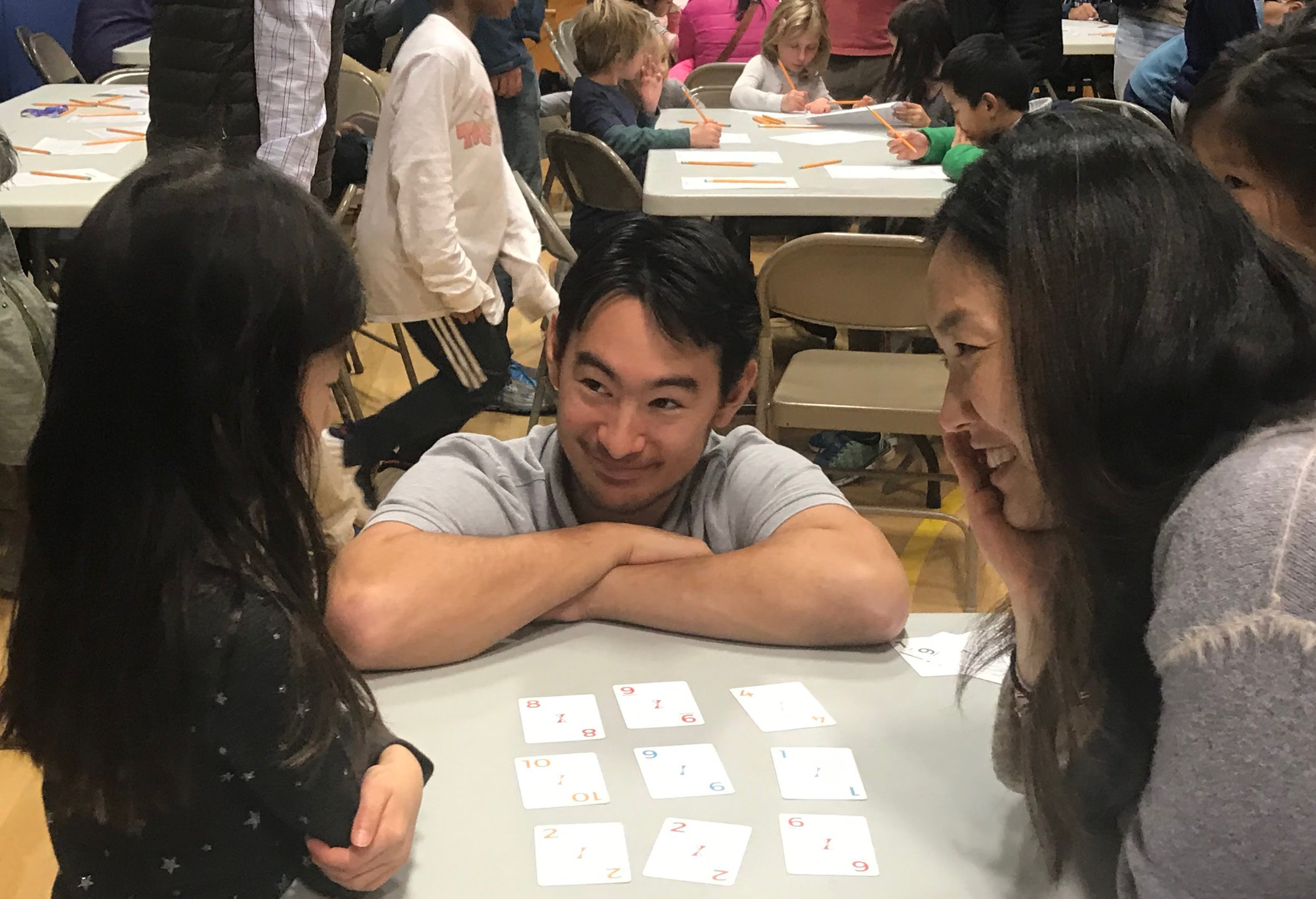 Greg Tang, Jr. helps an Old Bonhomme Elementary student learn math through visual pattern games.