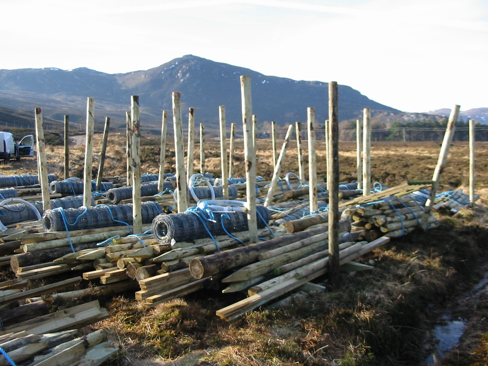 Bundles of deer fence materials waiting for helicopter uplift