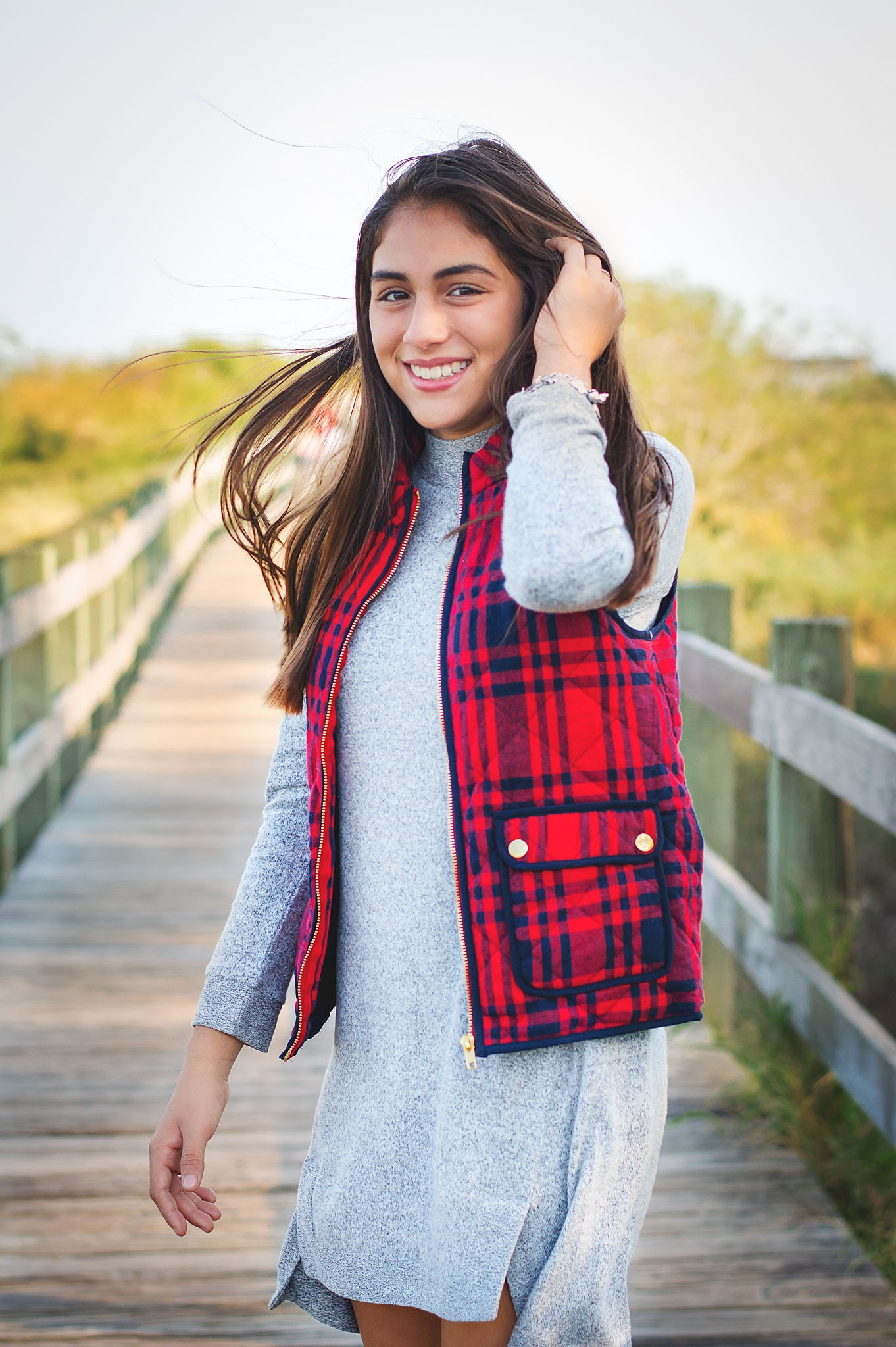 A simple solid dress is taken to a new level with the fun texture and bold color of the plaid vest.