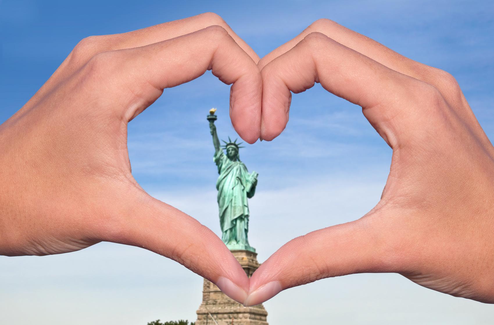 Heart hands around Statue of Liberty