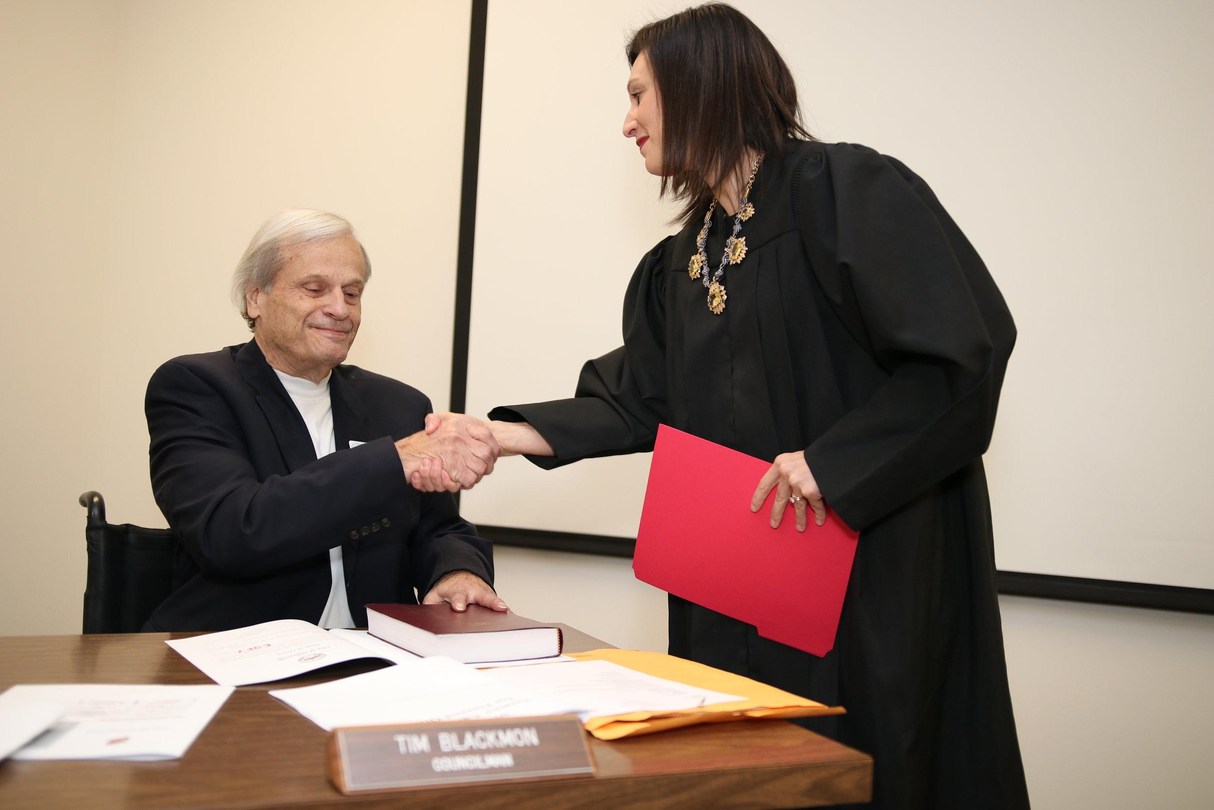 Tim Blackmon is sworn in by judge Ashley Gore.