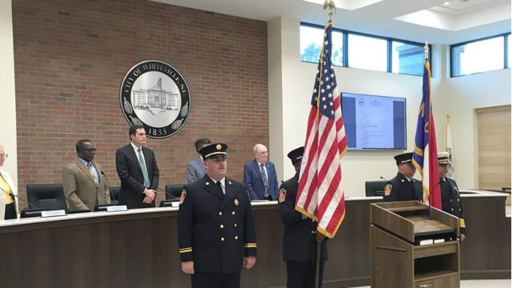 Whiteville City Council held its first meeting in its new chambers Tuesday. Shown opening the meeting is the Whiteville Fire Department color guard.