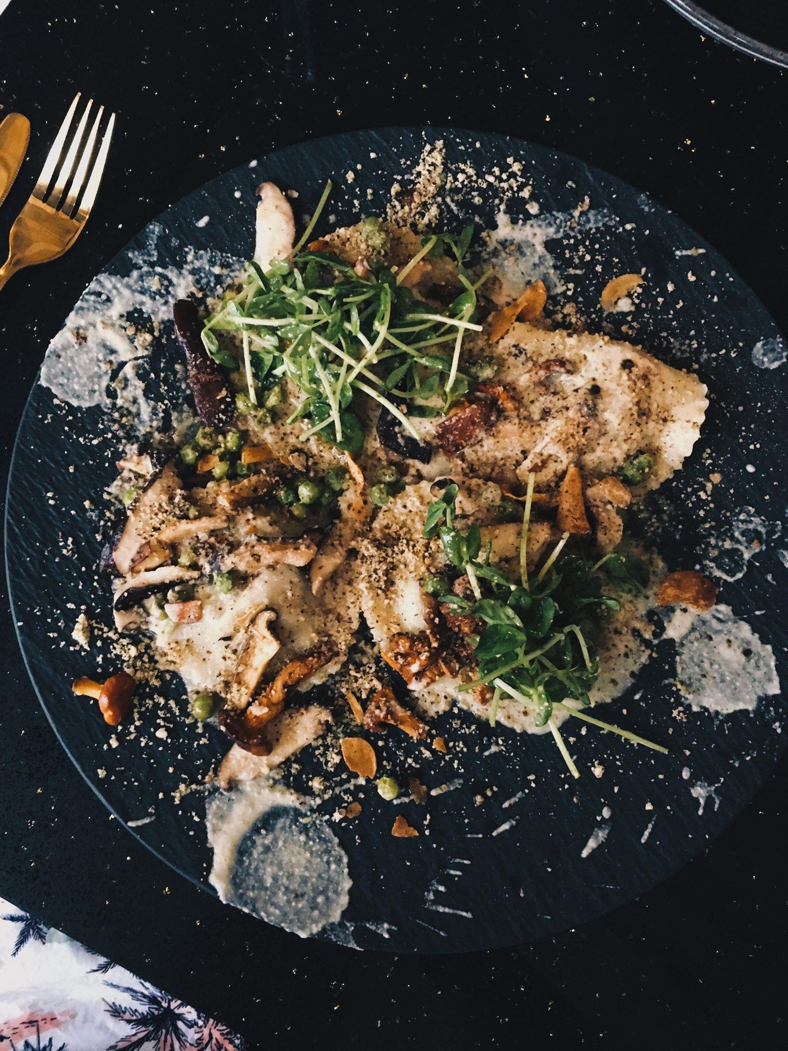Mushroom Ravioli; Handmade Ravioli, Mushroom Duxelle, Porcini Cream Sauce, Wild Mushroom, Green Peas, Hazelnut Crumb, Baby Greens, Garlic Chips, Truffled Lemon Vinaigrette, Porcini Dust