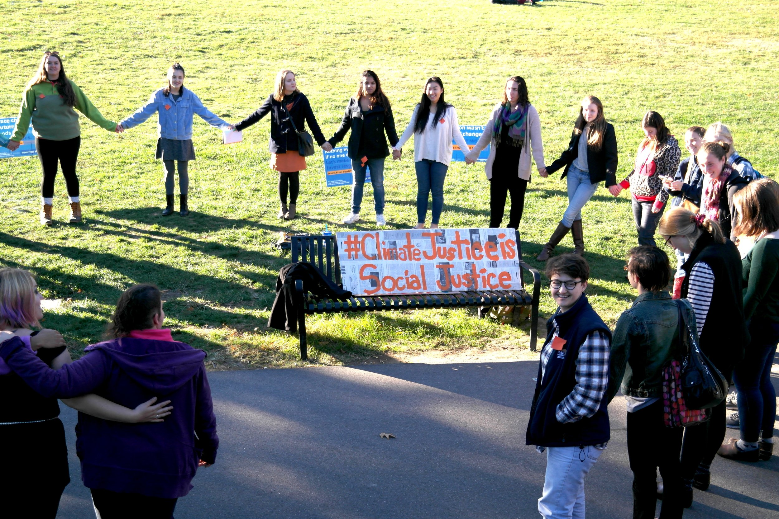 Photo by Katie Reynolds '19 Students gathered on Skinner Green to advocate for climate justice in a rally featuring student speakers.