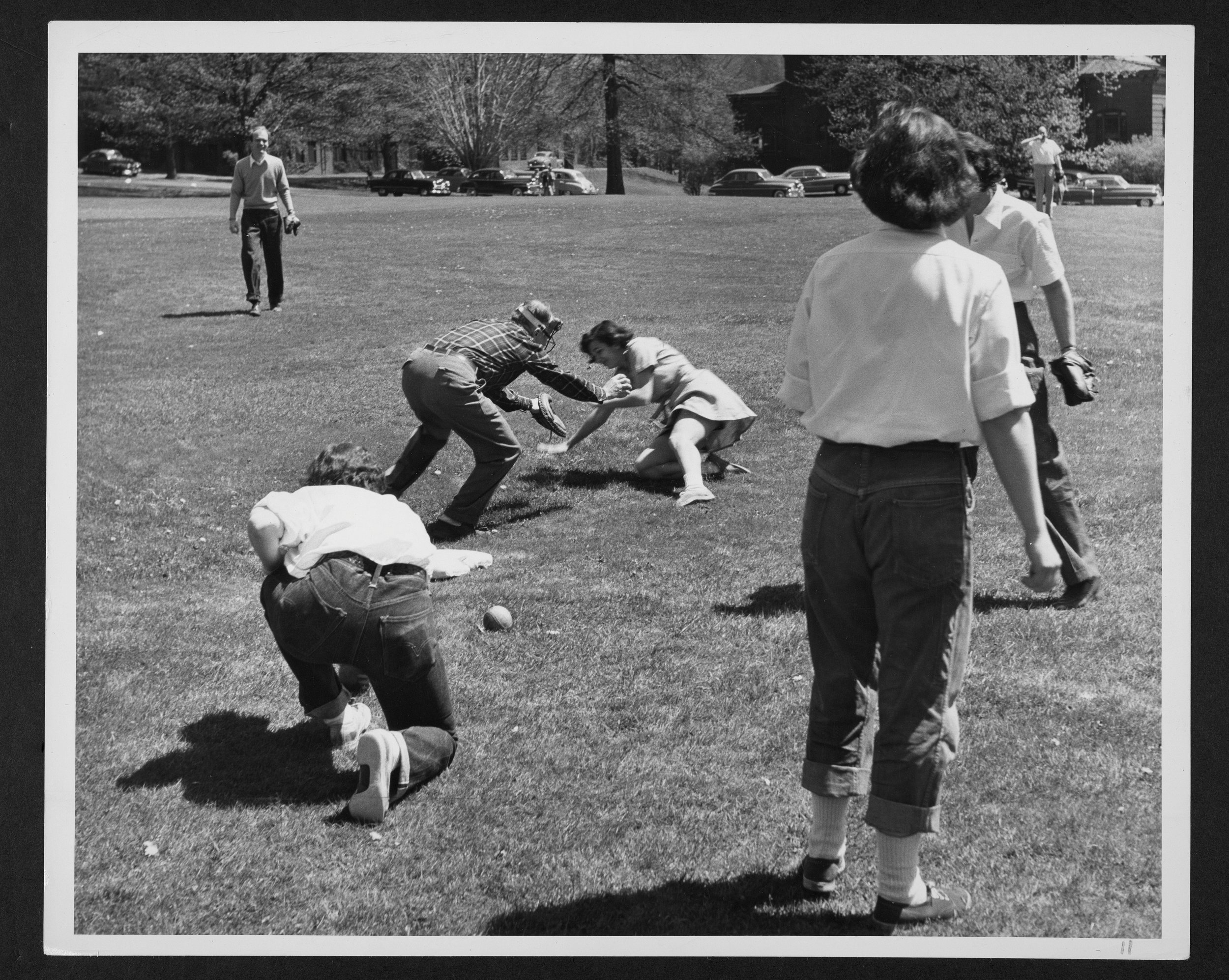 Family members playing baseball during 1957 Parents' Weekend.
