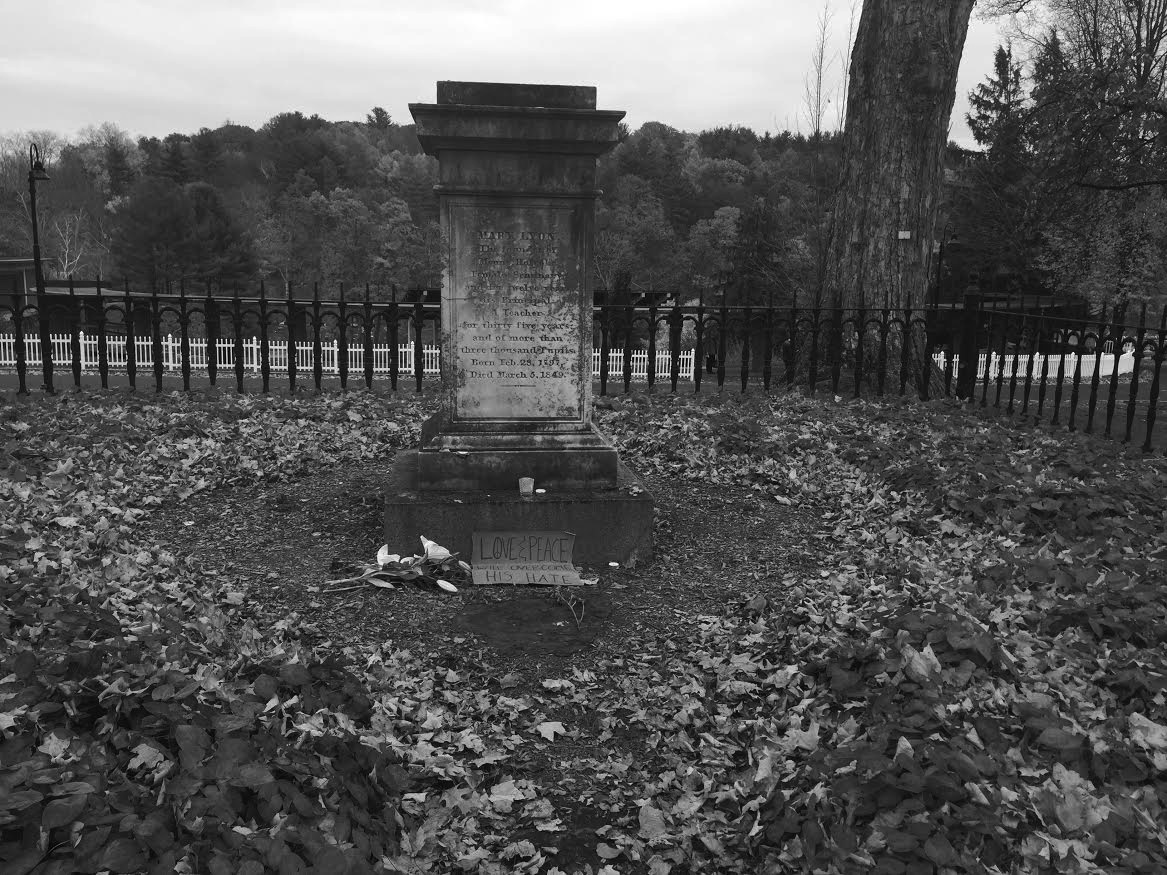 Photo by Hannah Roach '17 Founder Mary Lyon's grave was adorned with flowers, candles and signs celebrating love and peace.
