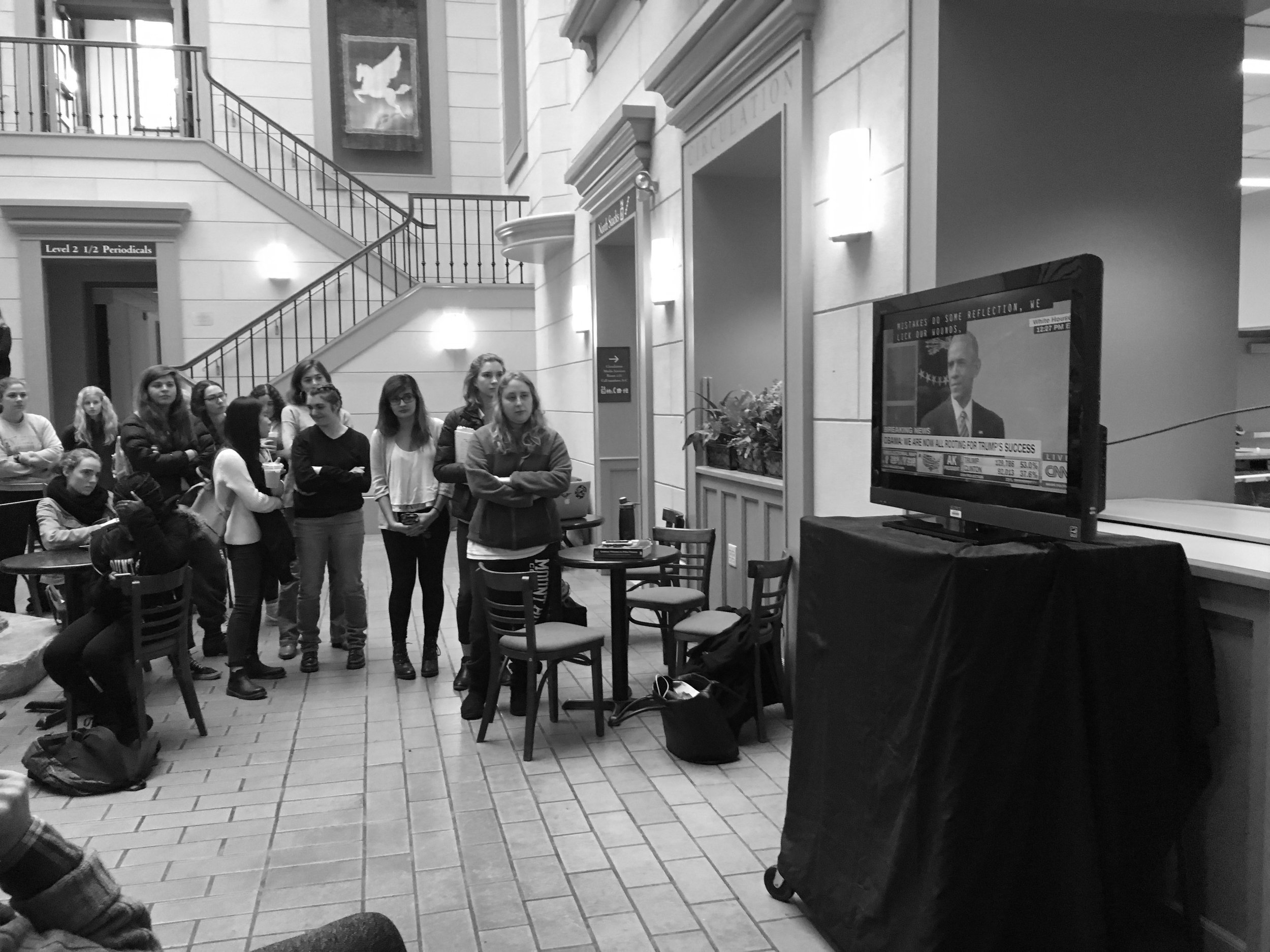Photo by Leah Willingham '17 Students and other members of the MHC community watch President Obama's response to Trump taking the presidency.