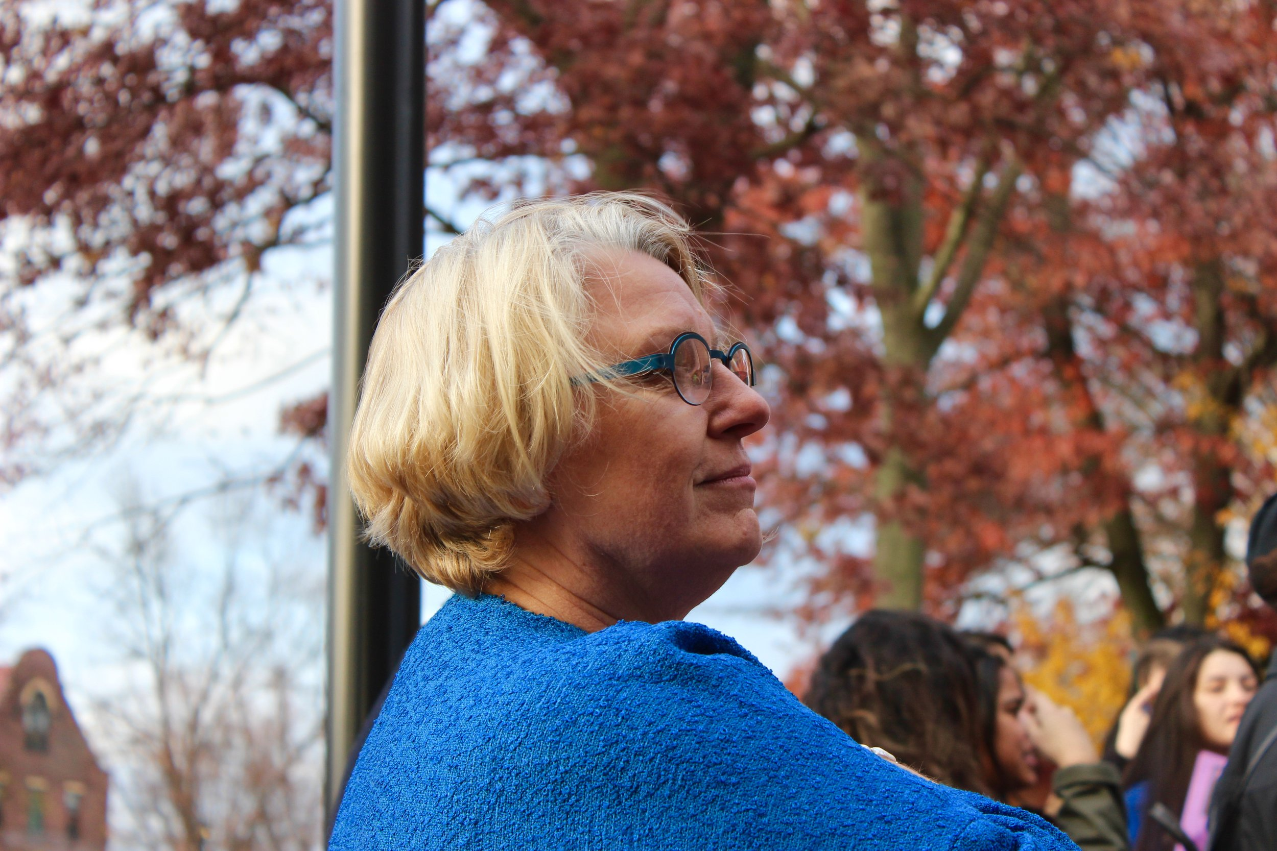 Photo by Emily Tarantini '18  President Sonya Stephens listens to protesters' demands during the MHC #SanctuaryCampus walkout on Nov. 16.