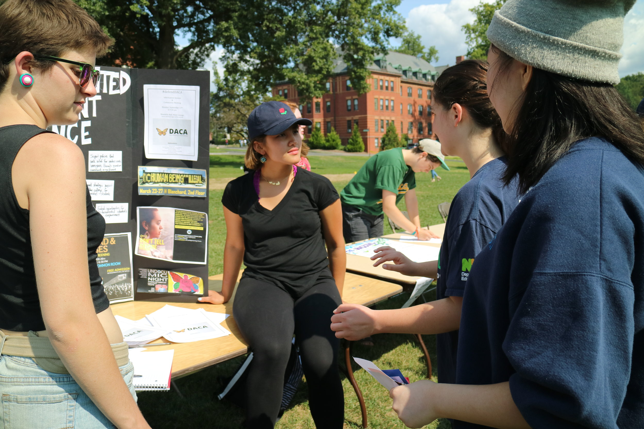 Photo by Yingke Yang '20    Students learn about the Undocumented Students Alliance from current members at the Involvement Fair.