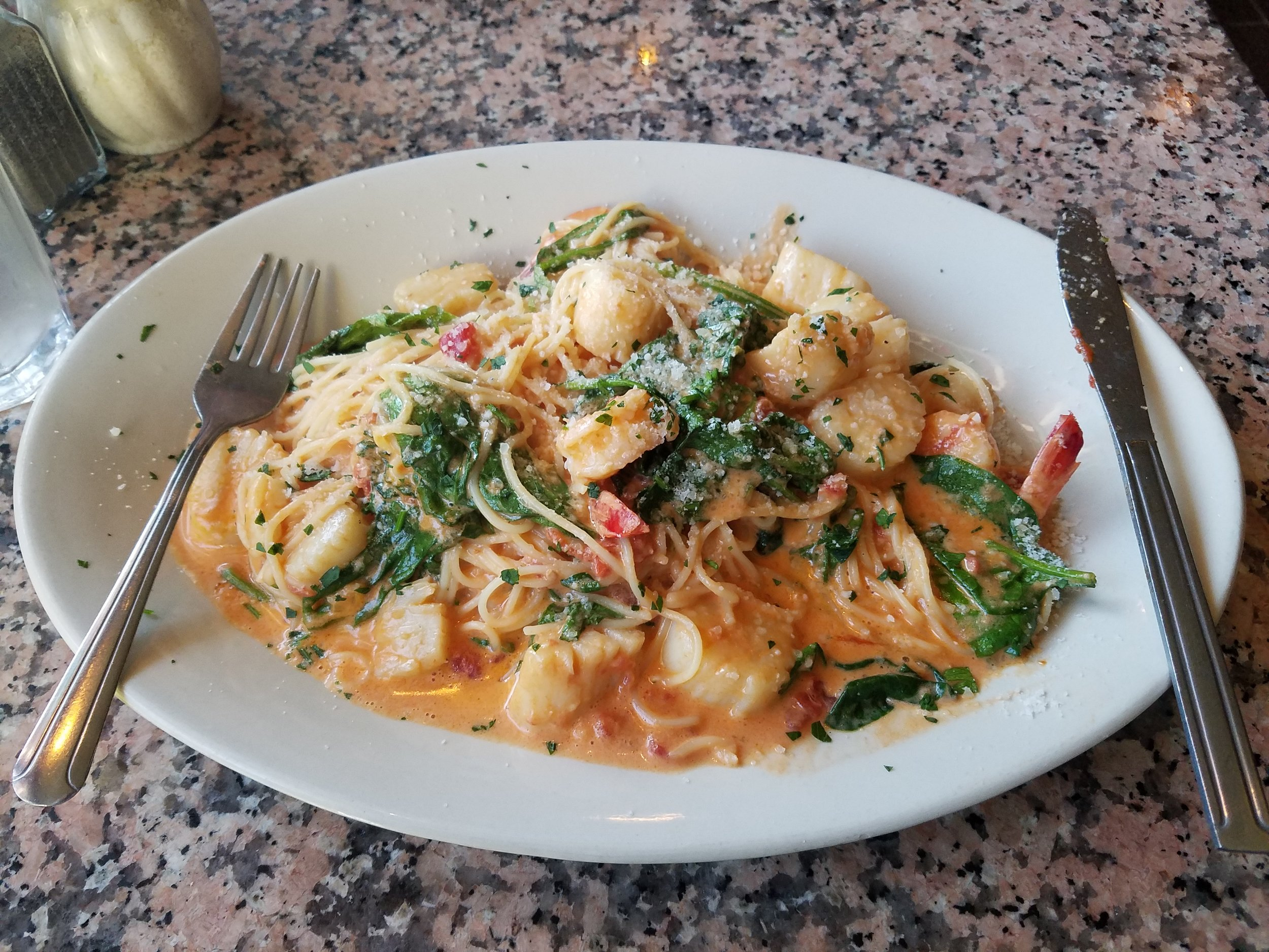 Photo by Sarah Paust '20  Pasta E Basta's spaghetti with scallops, shrimp and spinach in a tomato cream sauce, ordered by the author.