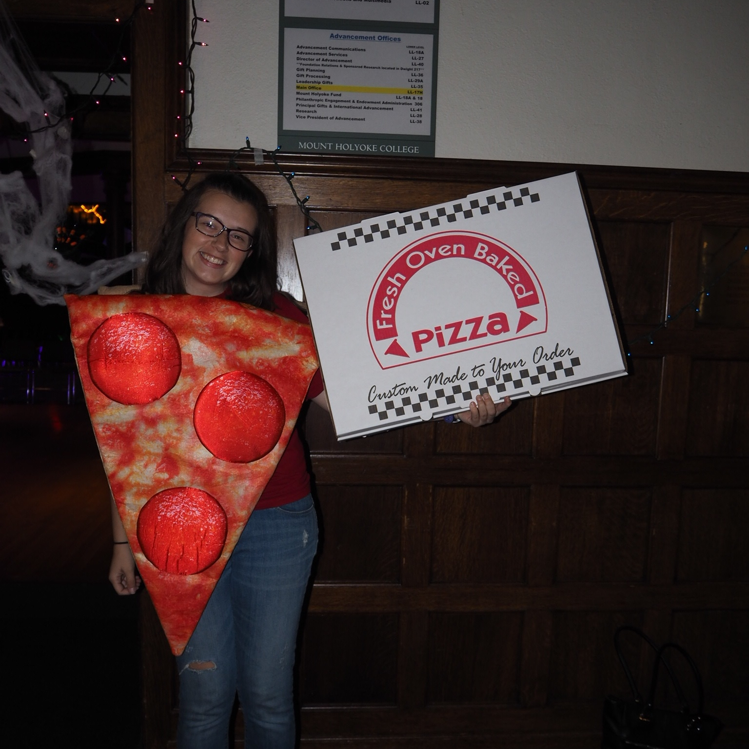 Student Event and Special Programs Coordinator Riley Fickett dressed as a slice of pizza on Saturday.
