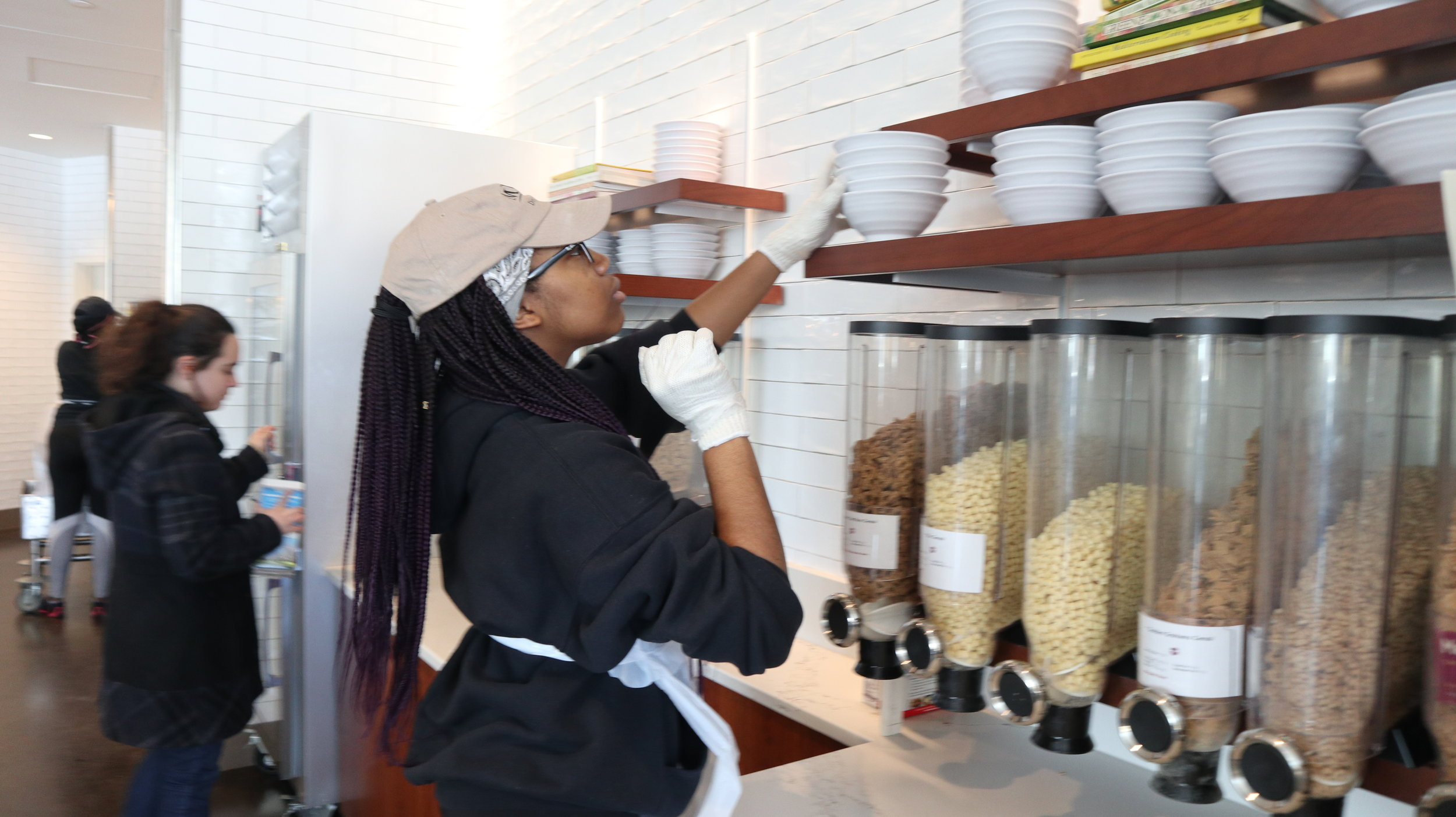 Photo by Yingke Yang '20  Deirdre Lewis '21, a student worker at the new Blanchard Dining Commons, restocks bowls above the cereal display