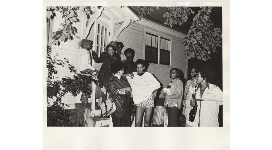 Photo courtesy of the Mount Holyoke College Archives and Special Collections  A group of students gathered outside of the Black Culture Center in an undated photo from the Archives.