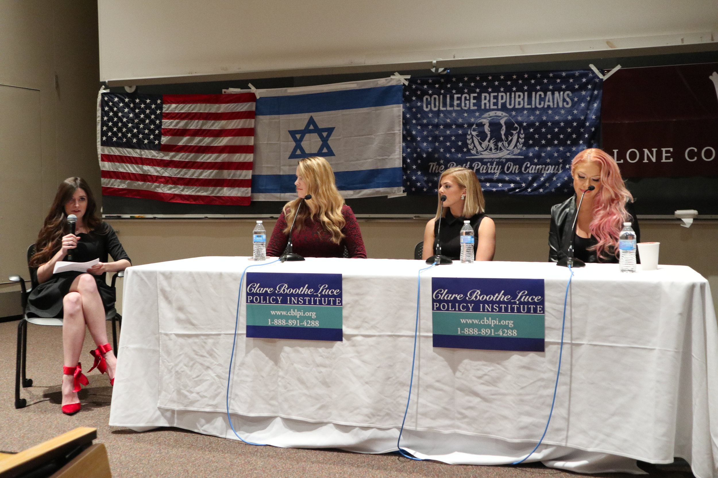 Photo by Yingke Yang '20  Kassy Dillon '18 (far left), president of Mount Holyoke College Republicans, interviews Beverly Hallberg, Ally Stuckey and Kaya Jones (left to right).