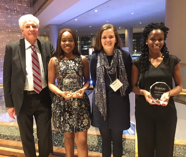 Photo courtesy of Sarah McCool '18  Professor Thomas White, Simi Esan '18, Sarah McCool '18 and Tracy Keya '18 pose with their IBECC trophy.
