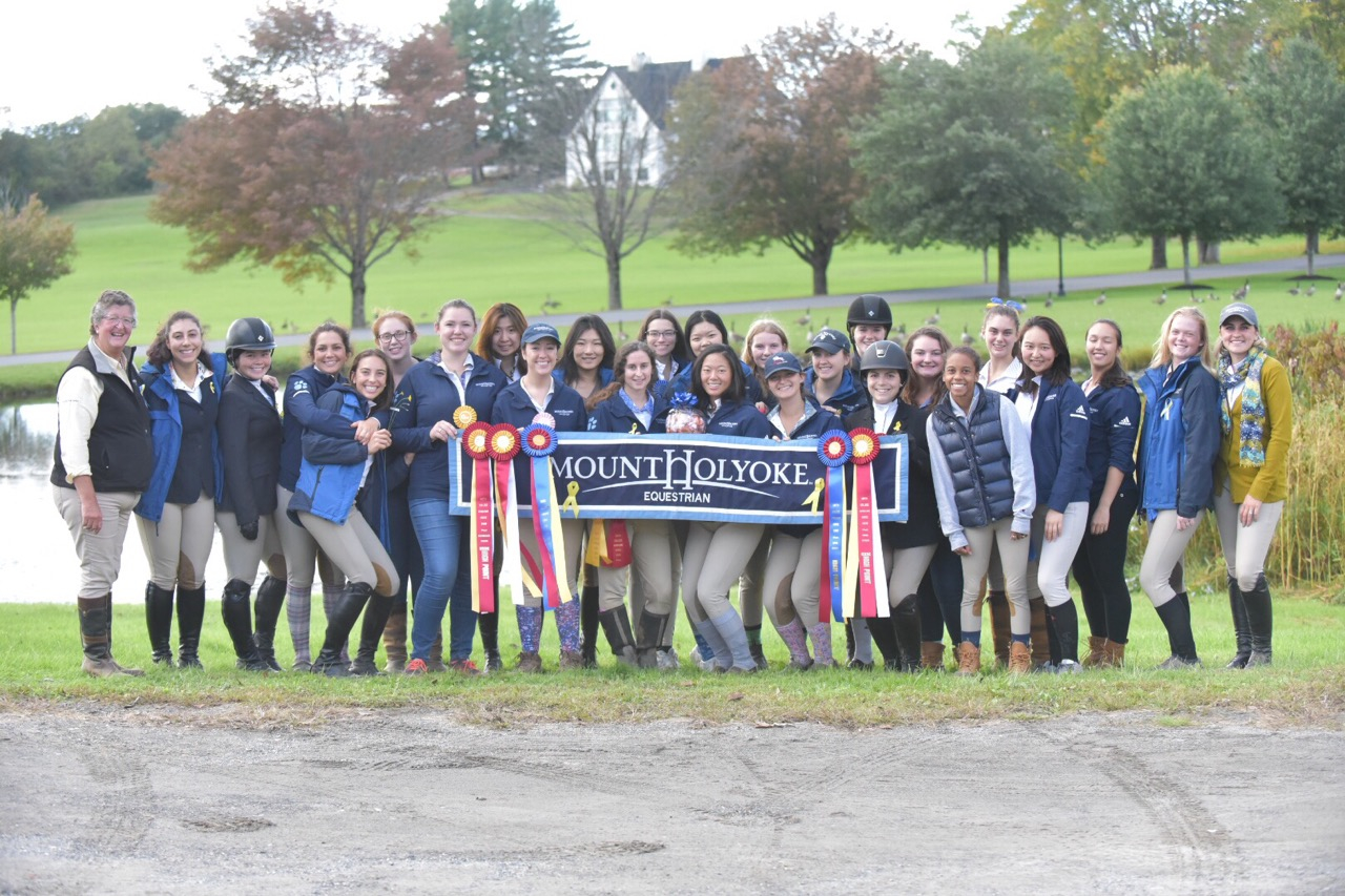 Photo courtesy of Ana Earle '22   The Mount Holyoke Equestrian team poses for a photo with their ribbons earned at the Smith College Show