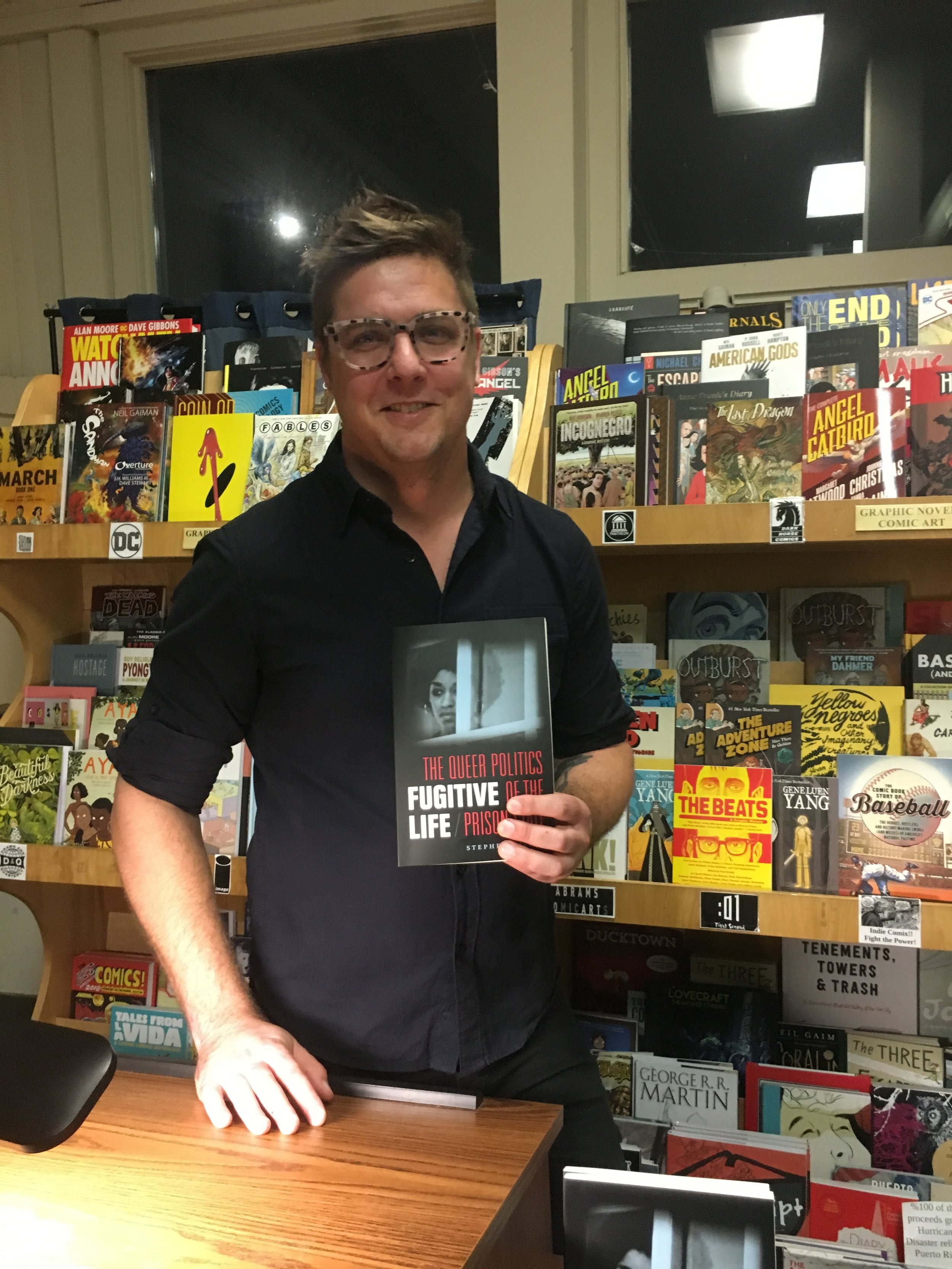 Photo by Isabel Rodriguez '21   Stephen Dillon poses with his new book at Amherst Books on Friday