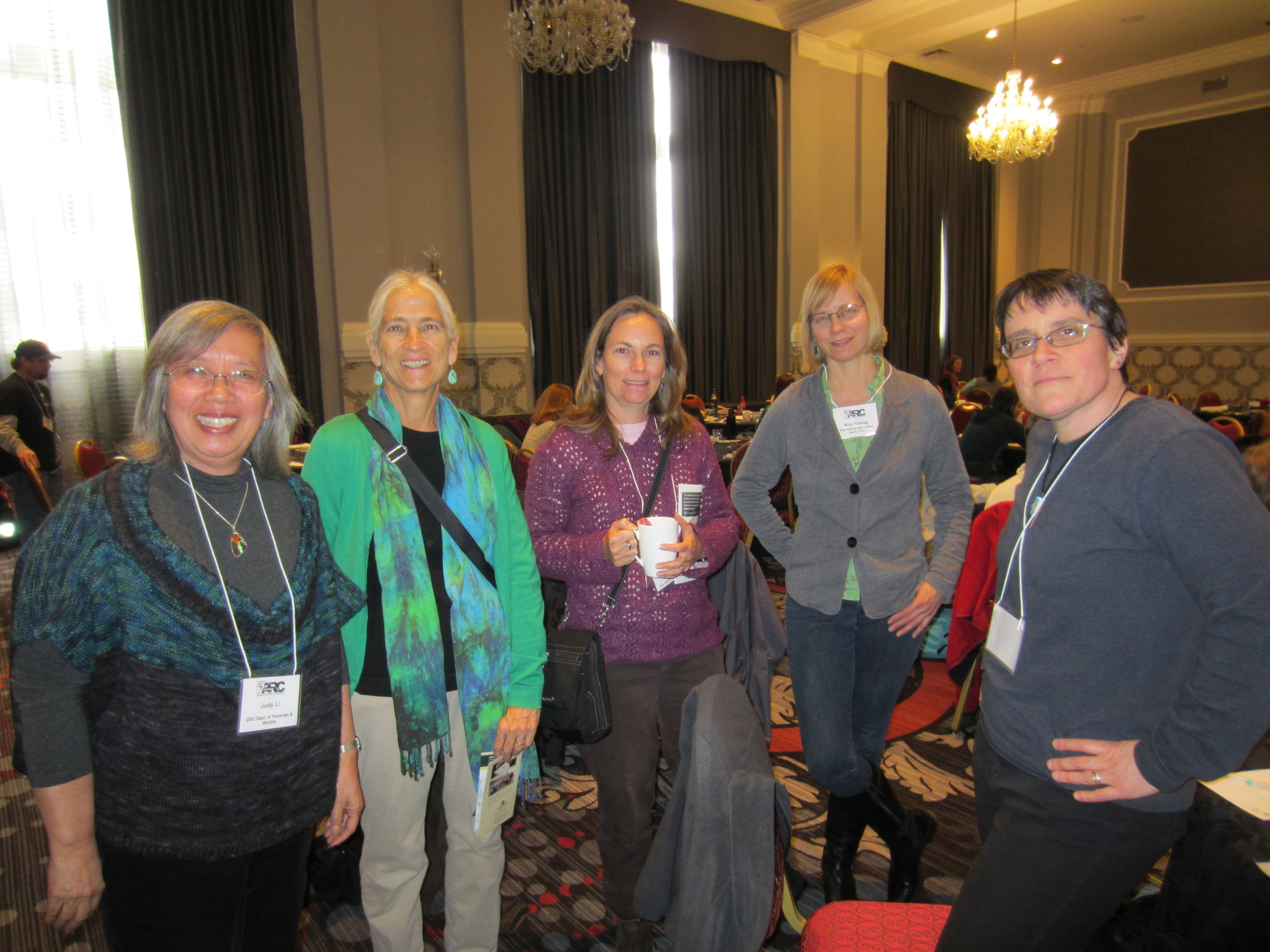 Sharman Apt Russell (second from left) and Celeste Searles Mazzacano (far right) with meeting participants.