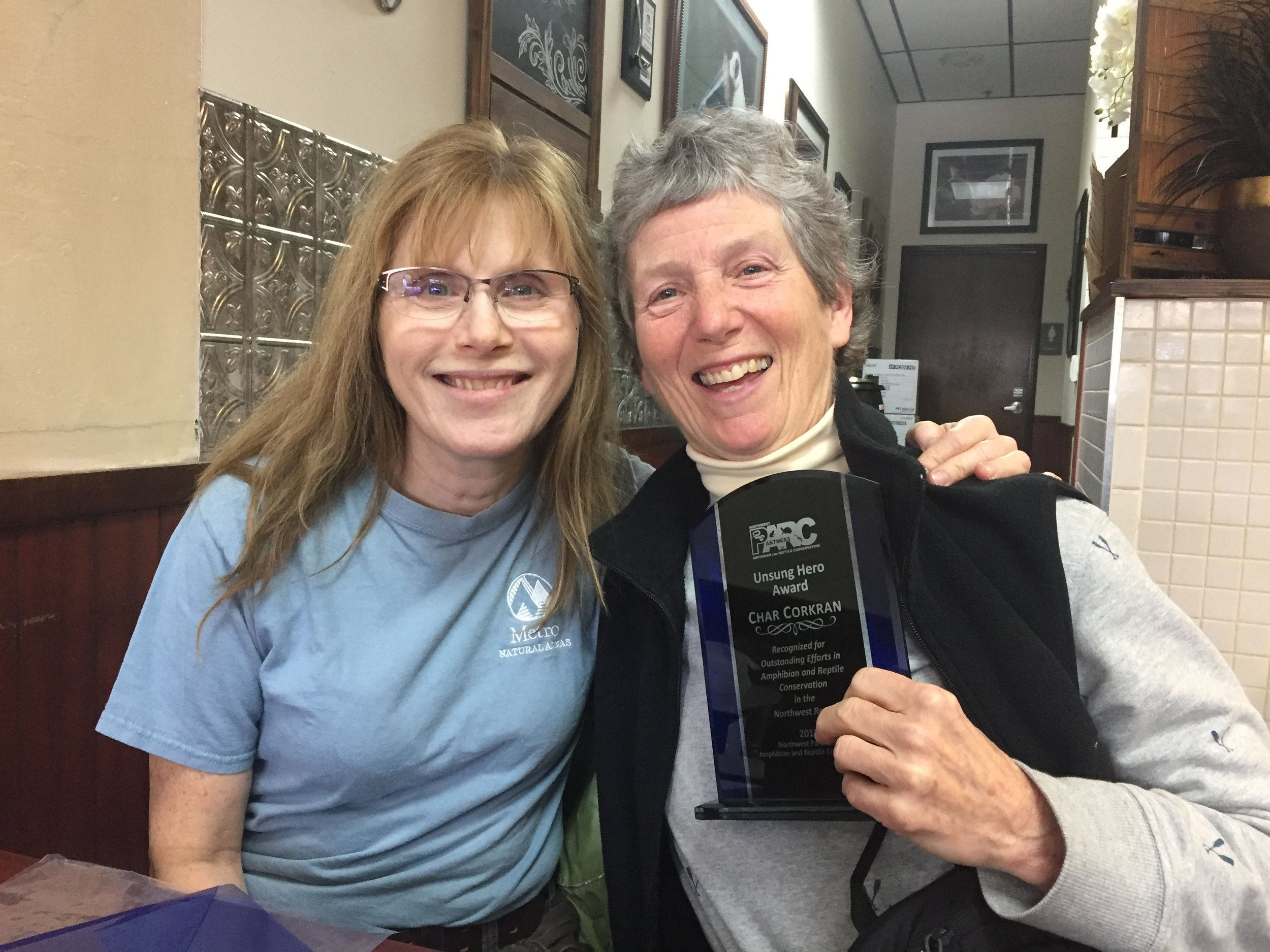 NW PARC co-chair Katy Weil presenting Char Corkran with her award