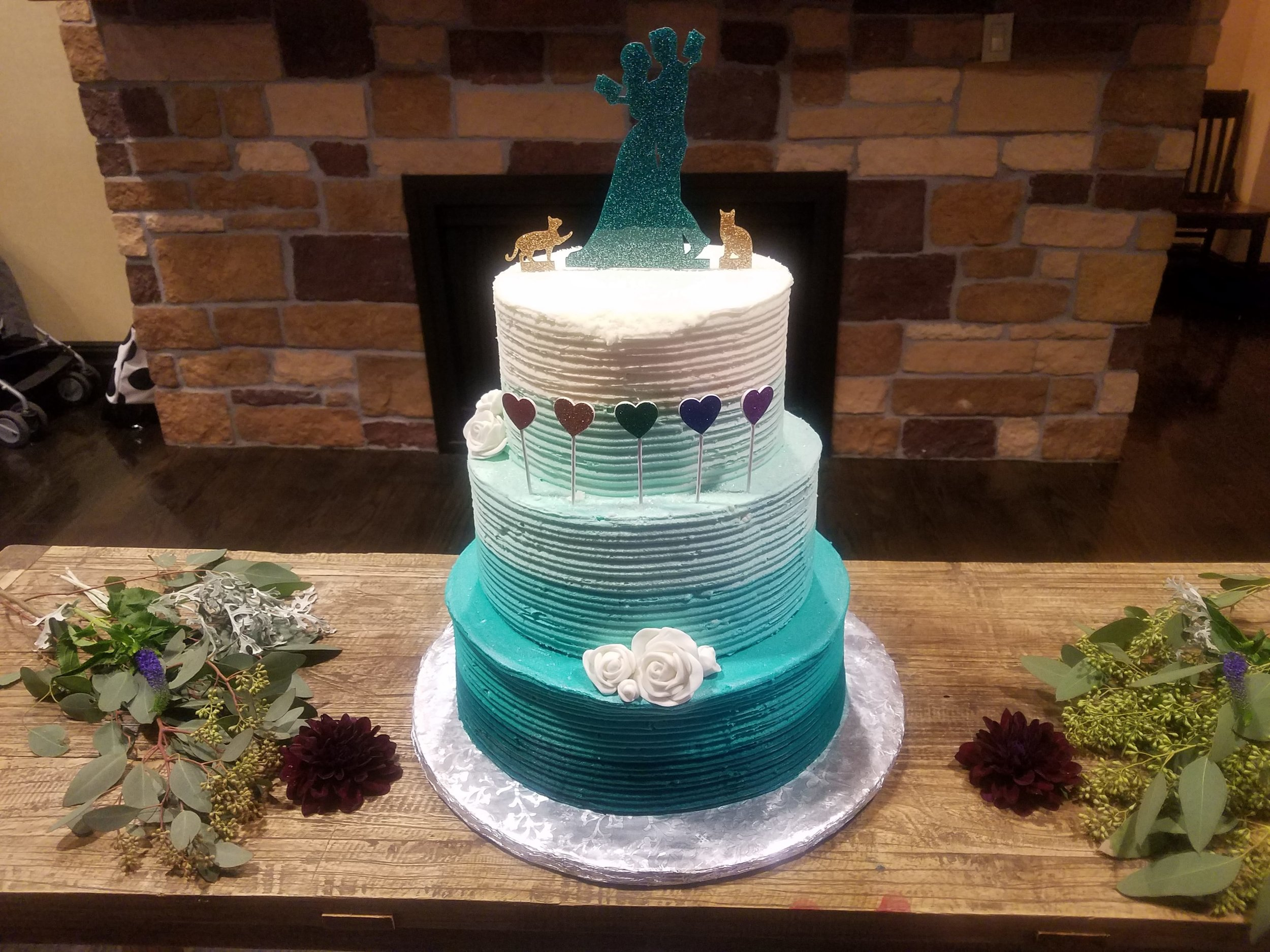Ombre Cakes - A wedding I entertained at last year had a beautiful ombre cake with faded blues and greens. Ombre is the gradual blending of one color hue to another, usually moving tints and shades from light to dark.This is a great gender-neutral example for same-sex weddings. Check out other ombre cake ideas here.