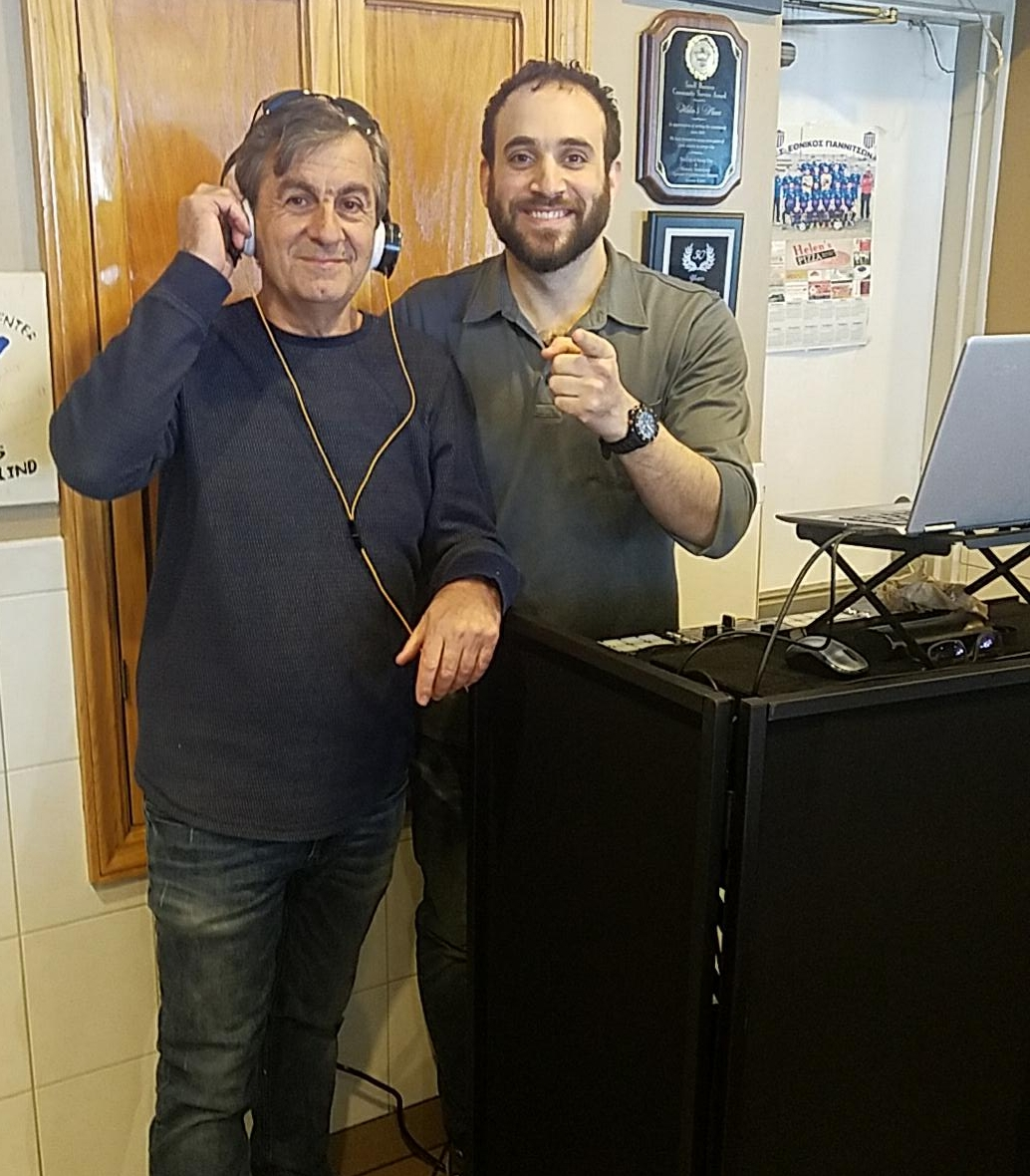 Steven Kalcanides of Helen's Pizza in Jersey City - Steven, the owner of Helen's Pizza, making sure I have the correct version of Zorba the Greek.