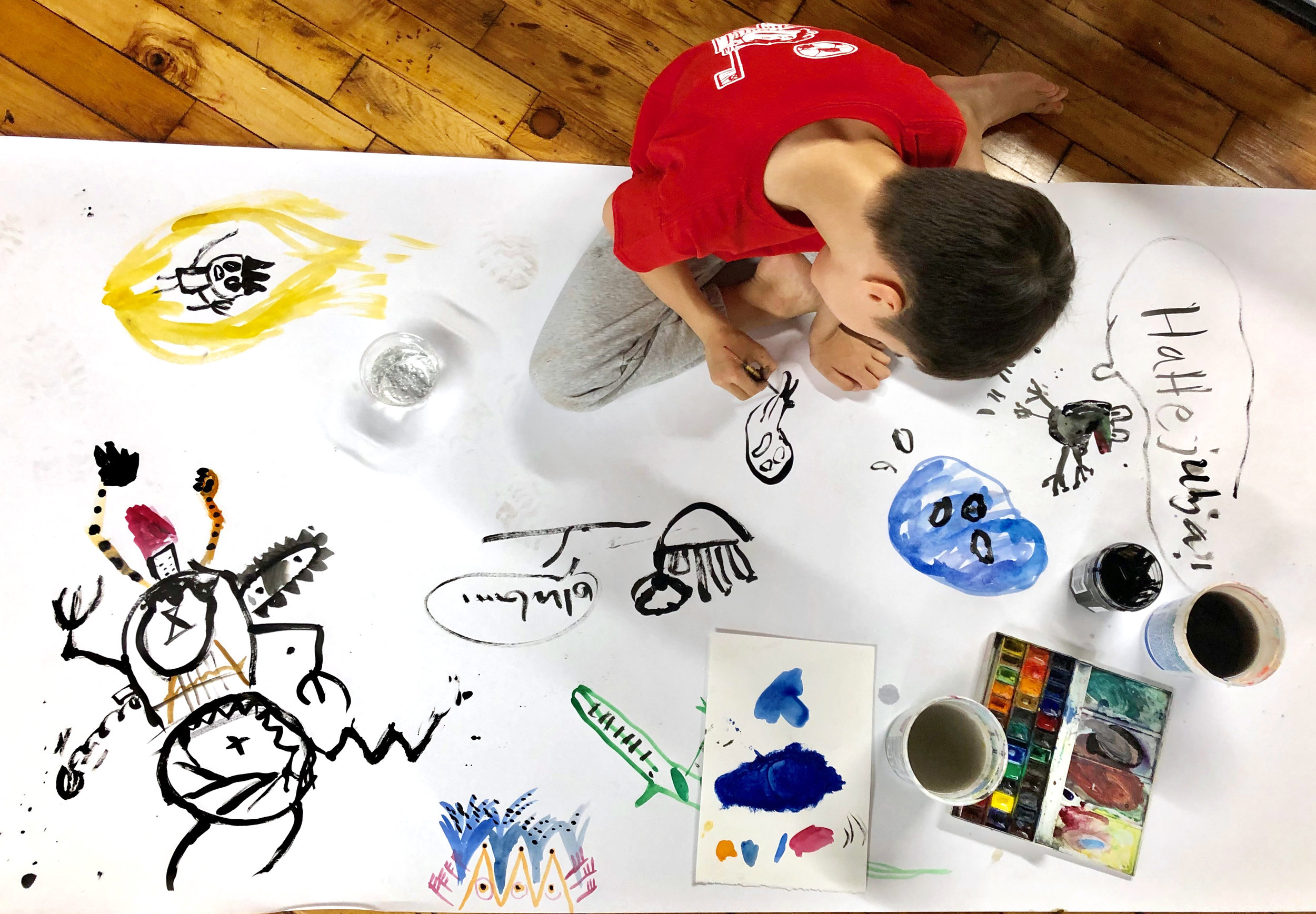 Kai is drawing with ink and watercolor.