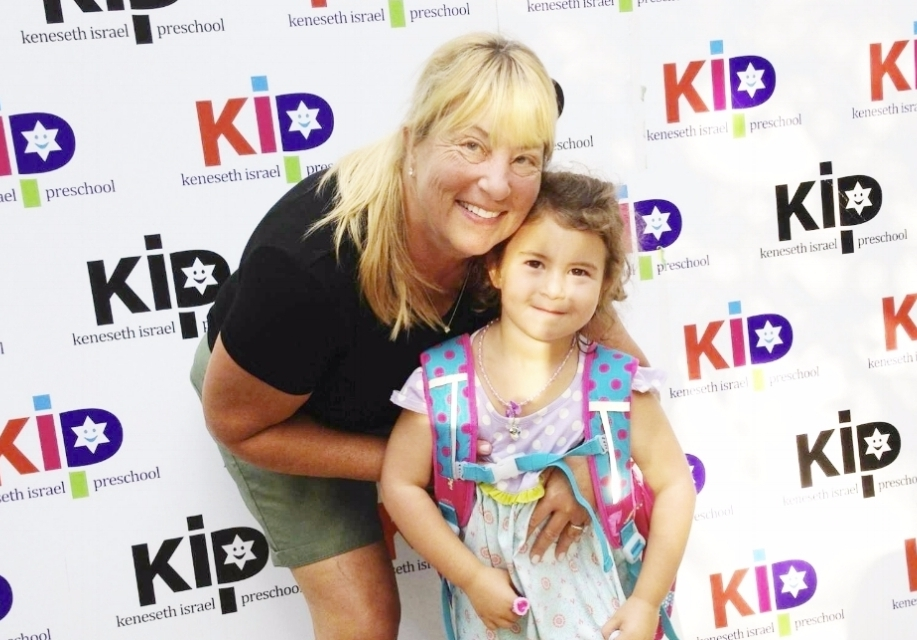 Director, Shary Loewy Hyman, poses with a KIP student on the first day of school.