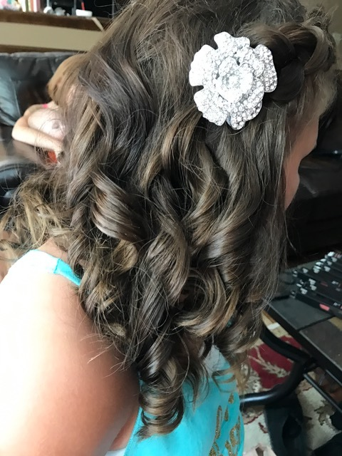 Junior Bridesmaid: Such a pretty girl!! She was so helpful all day long and kept her hands out of her curls for the entire day. We braided her bangs back and the bride made the clips - so fun!