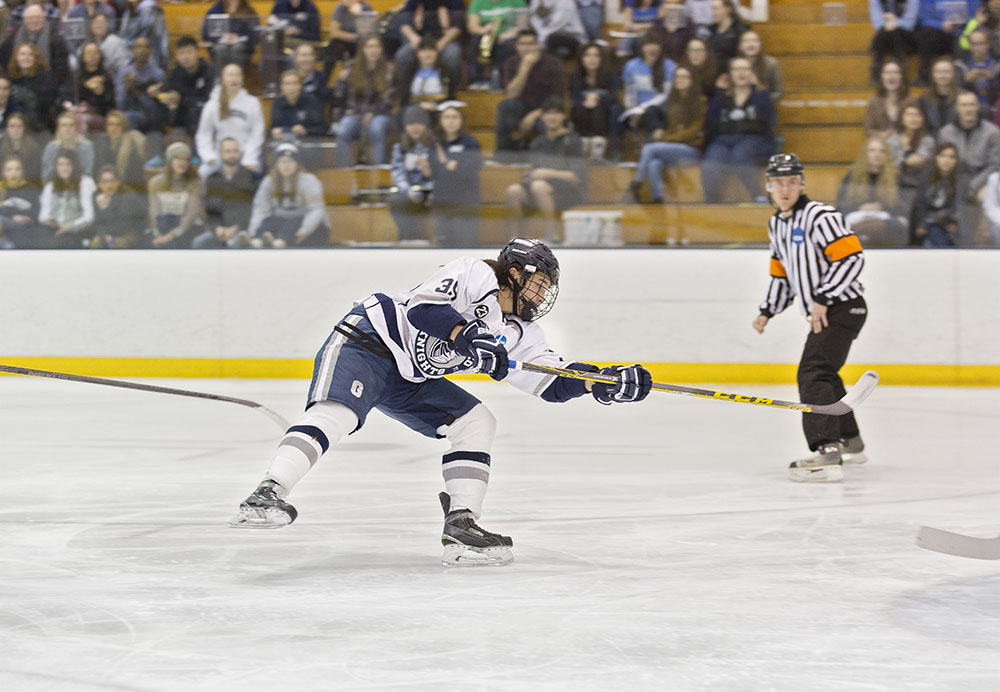 Sophomore forward Arthur Gordon takes a shot on net during a game at the Ira S. Wilson ice arena. The men have earned the No. 3 spot in the SUNYAC Tournament and look to claim another championship title. (Annalee Bainnson/Assoc. Photo Editor)